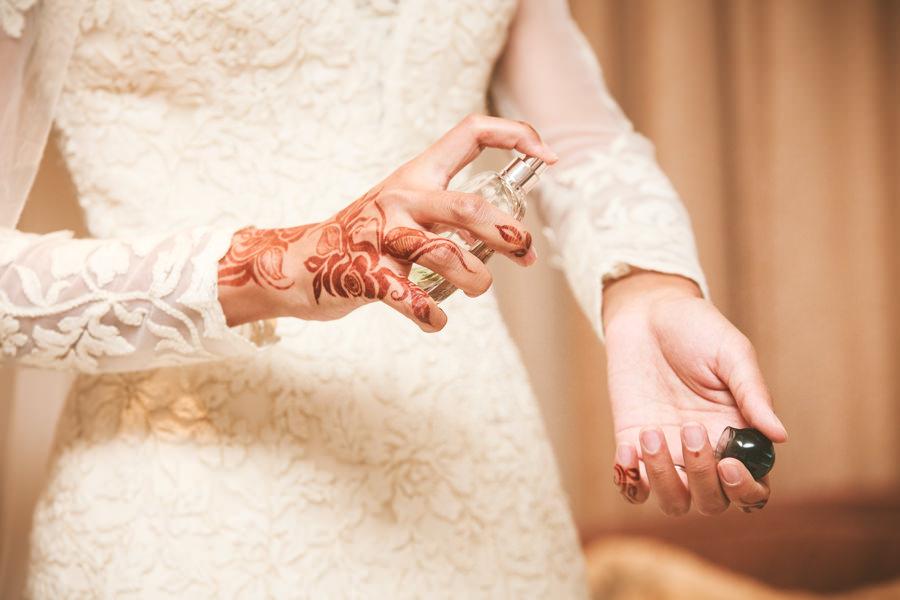 muslim bride getting ready applying perfume durban islamic