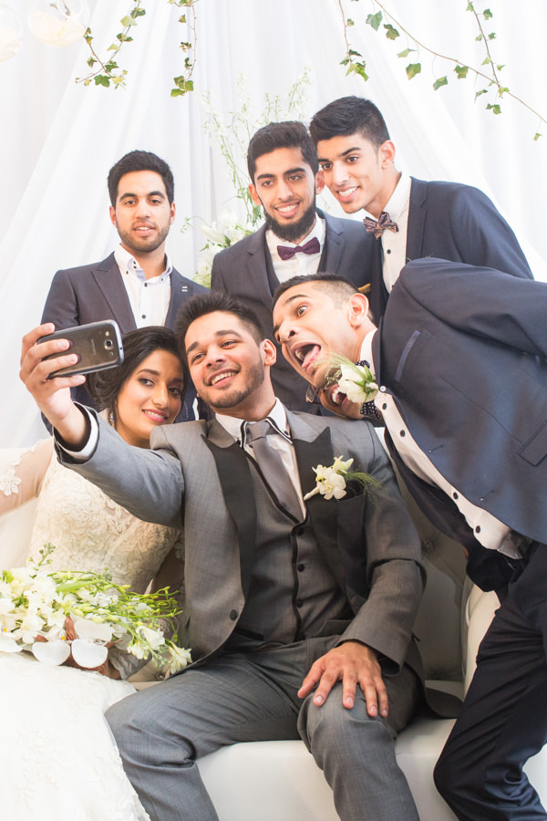 muslim bride and groom on stage with friends selfie laughing durban islamic