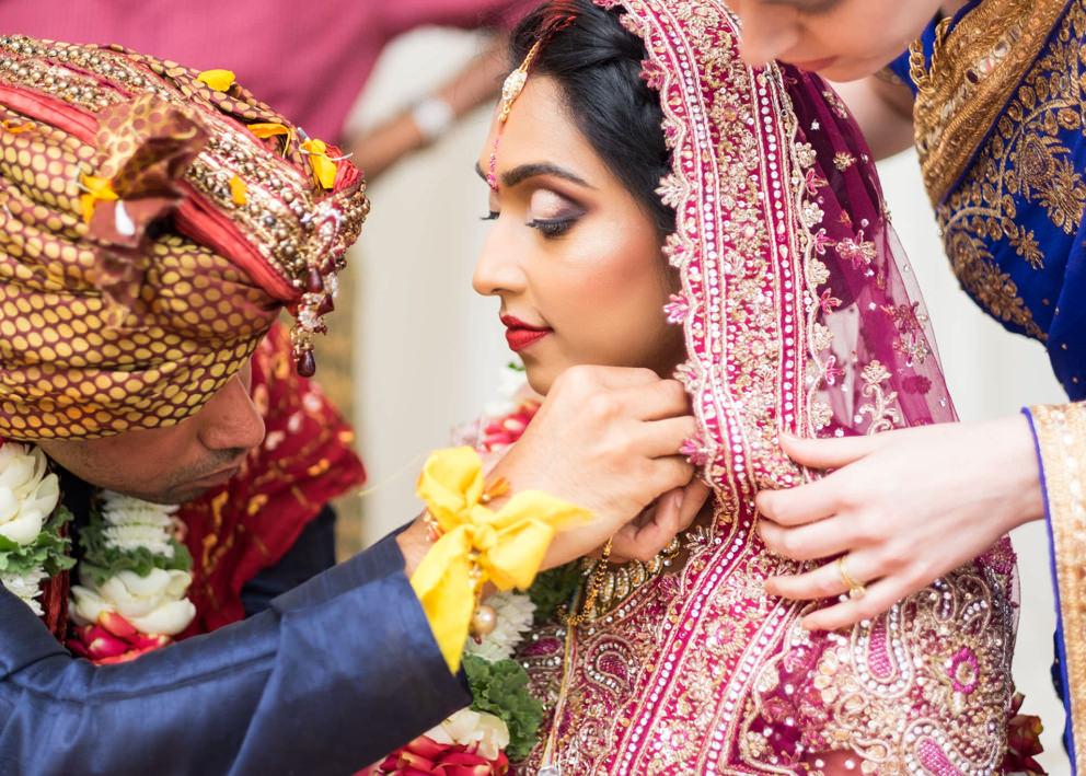 Umgeni Road Temple Wedding Photography groom tying thali