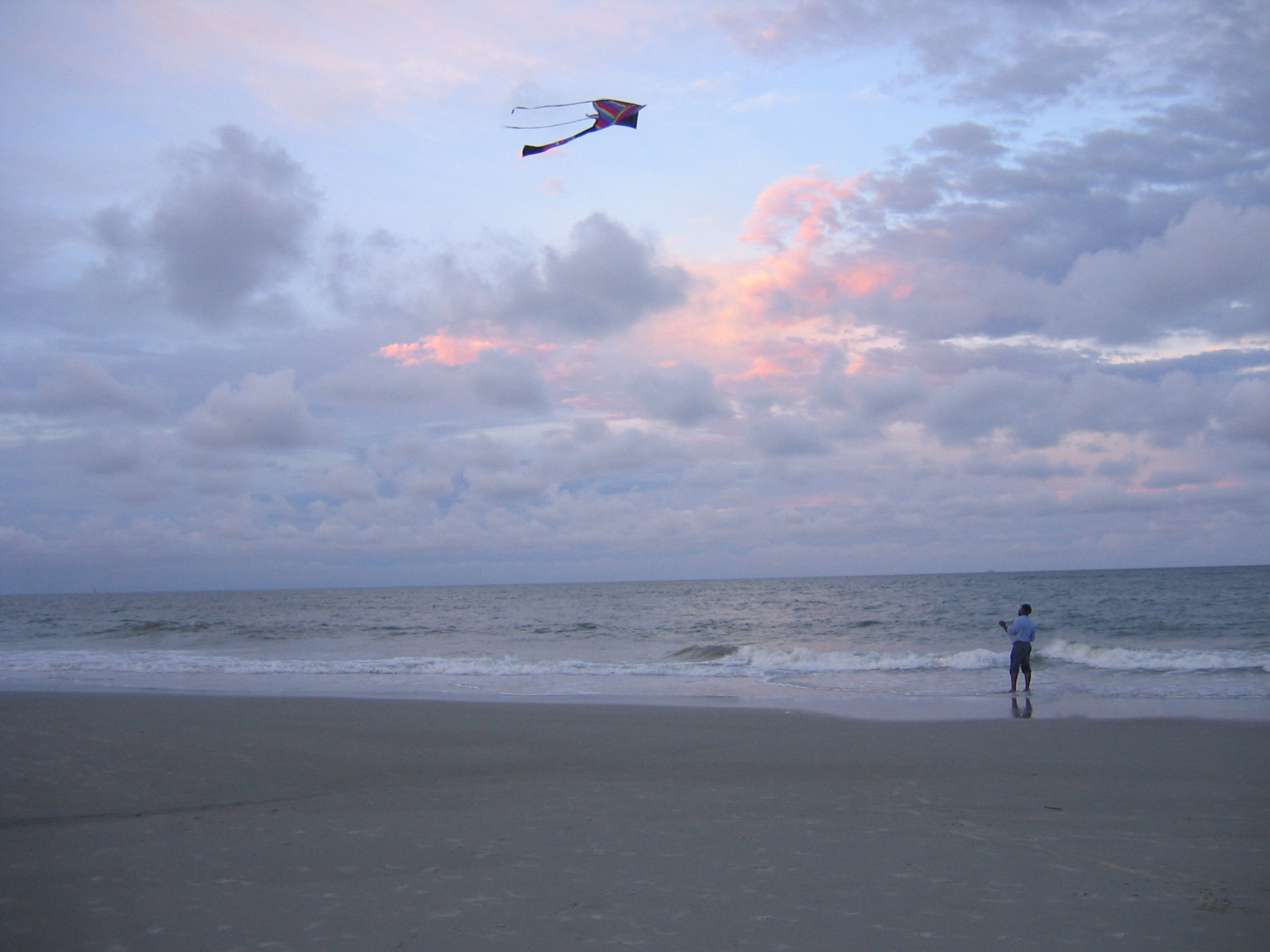 Man_flying_kite.jpg