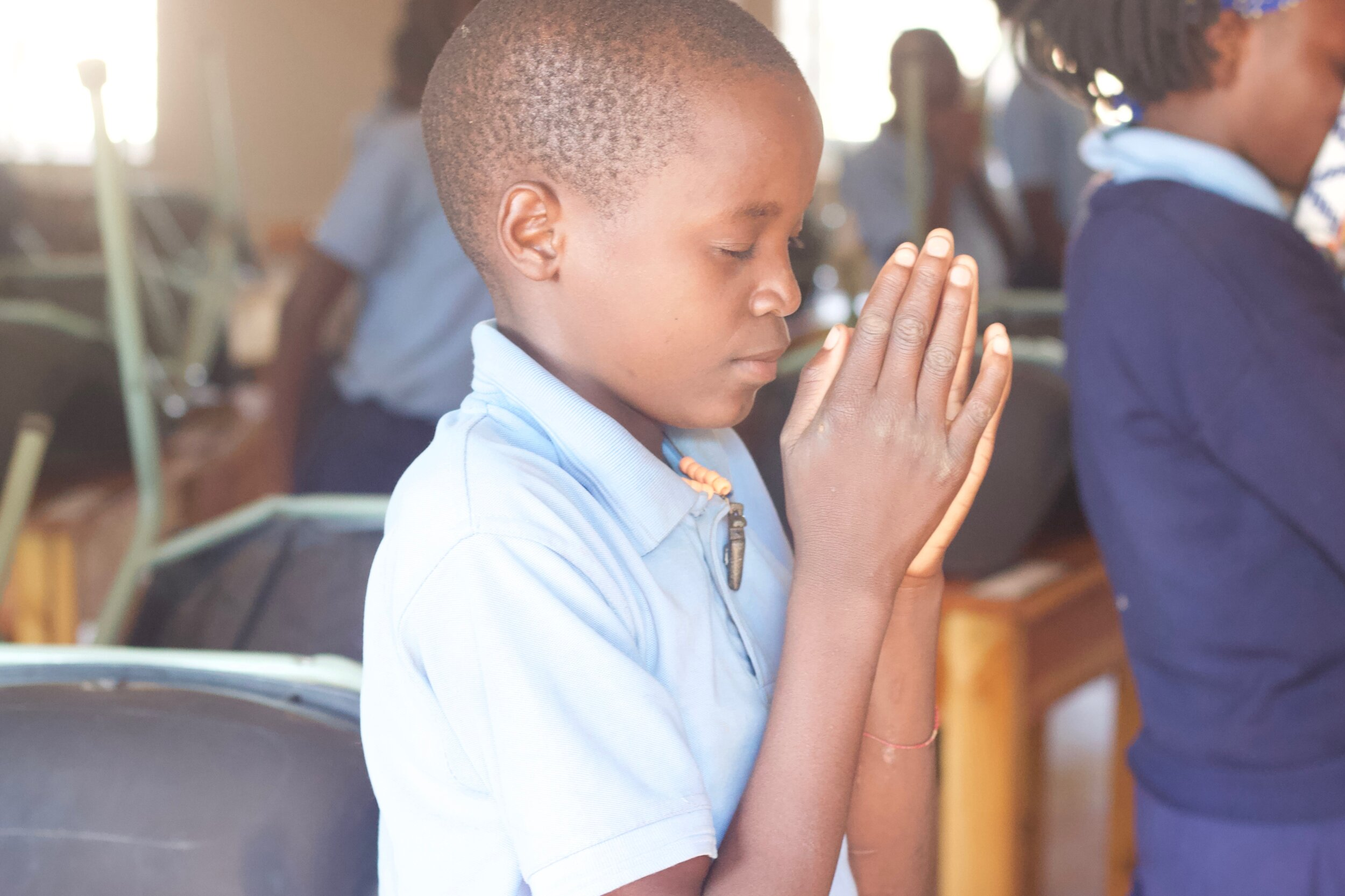 To finish school, students pray. They thank Him for what He does and how He shows His beauty, power, and love throughout the day. And they ask God to continue to bless them at home.