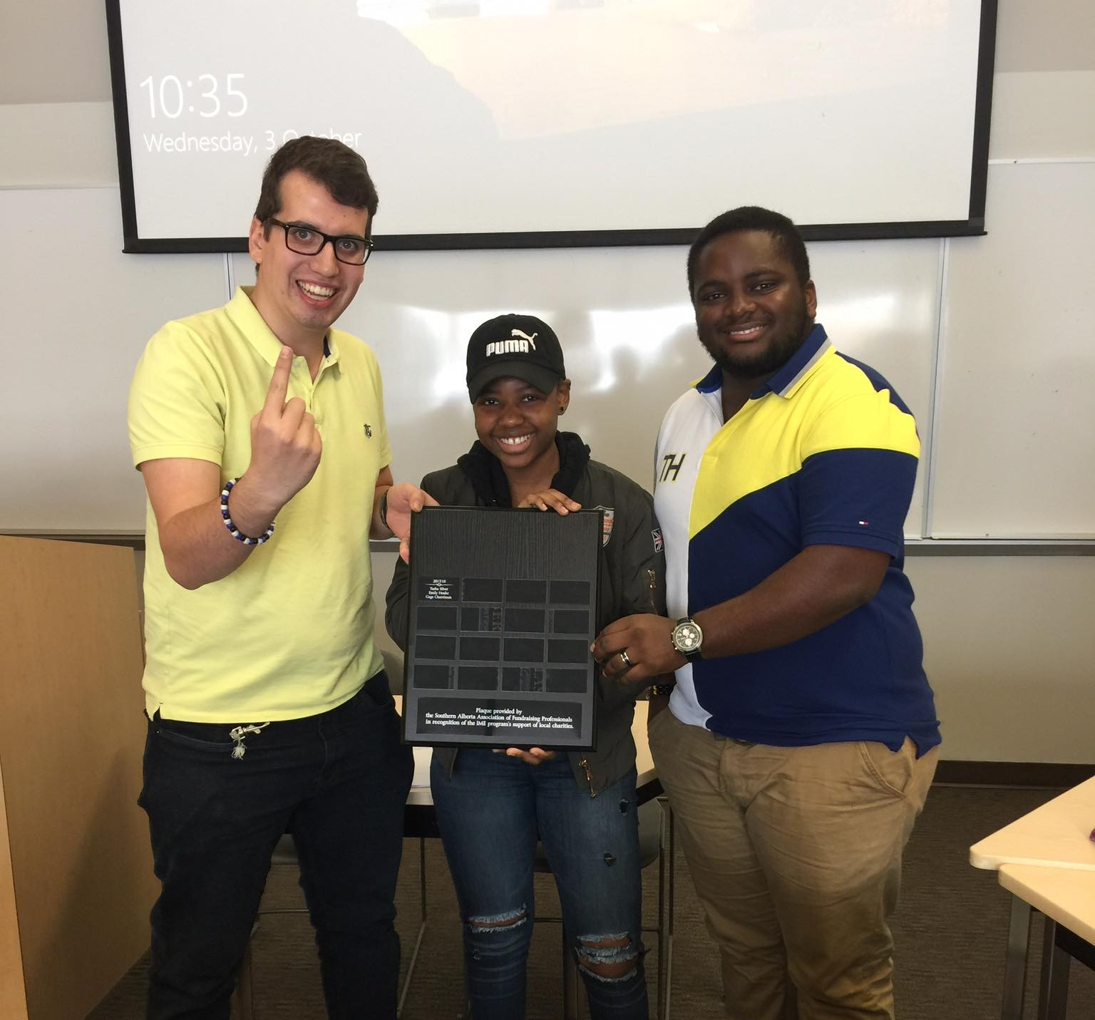 Winners of the 2018 IME internal case competition, Peter Hurd-Watler (left), Tabby Ndhlovu (middle), and Bill Nkeih (right).