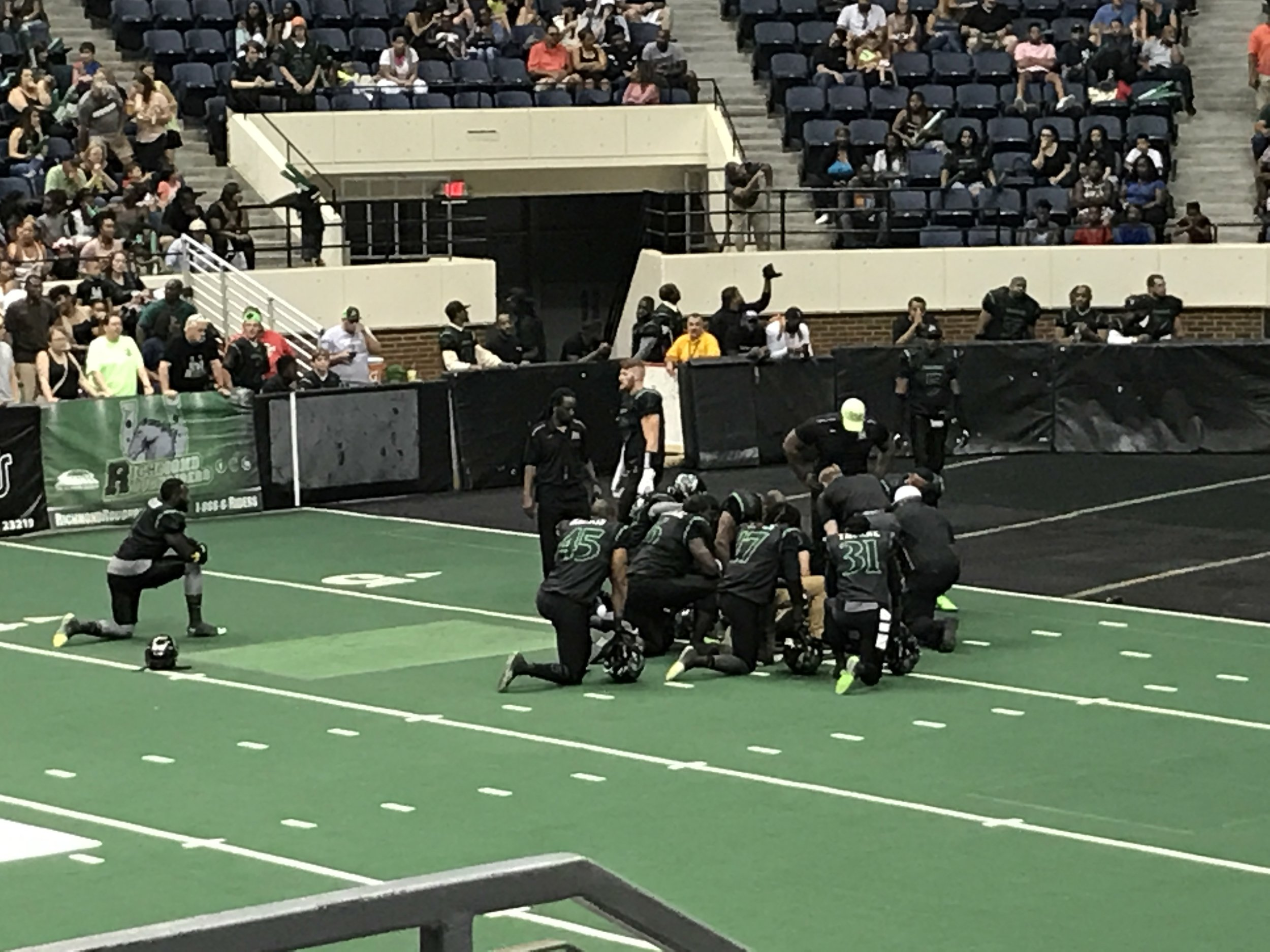 Here, the Rough Riders take a knee in support of their injured and only kicker.  They had to modify their strategy with kickoffs, extra points and filed goals.  Floating helps to repair injuries and to return to play more quickly.