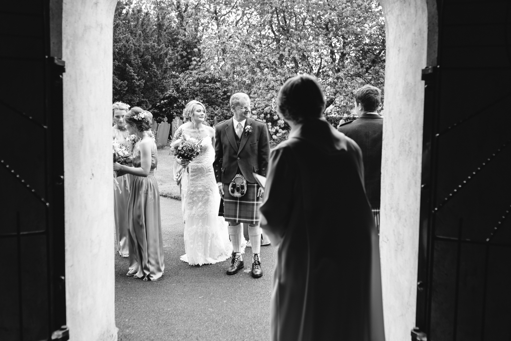 Bride waiting to enter Llanidloes church - Powys Wedding Photography