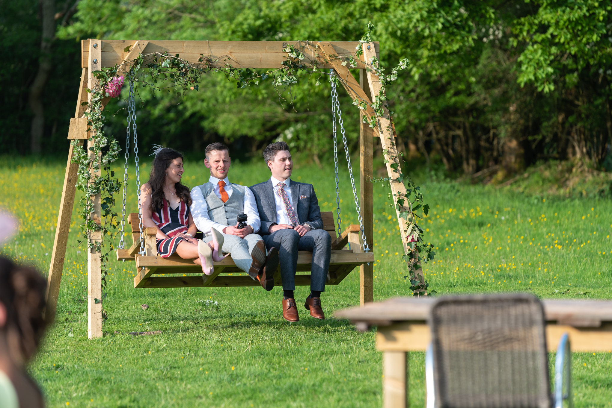 Wedding guests on swing - Powys Wedding Photography