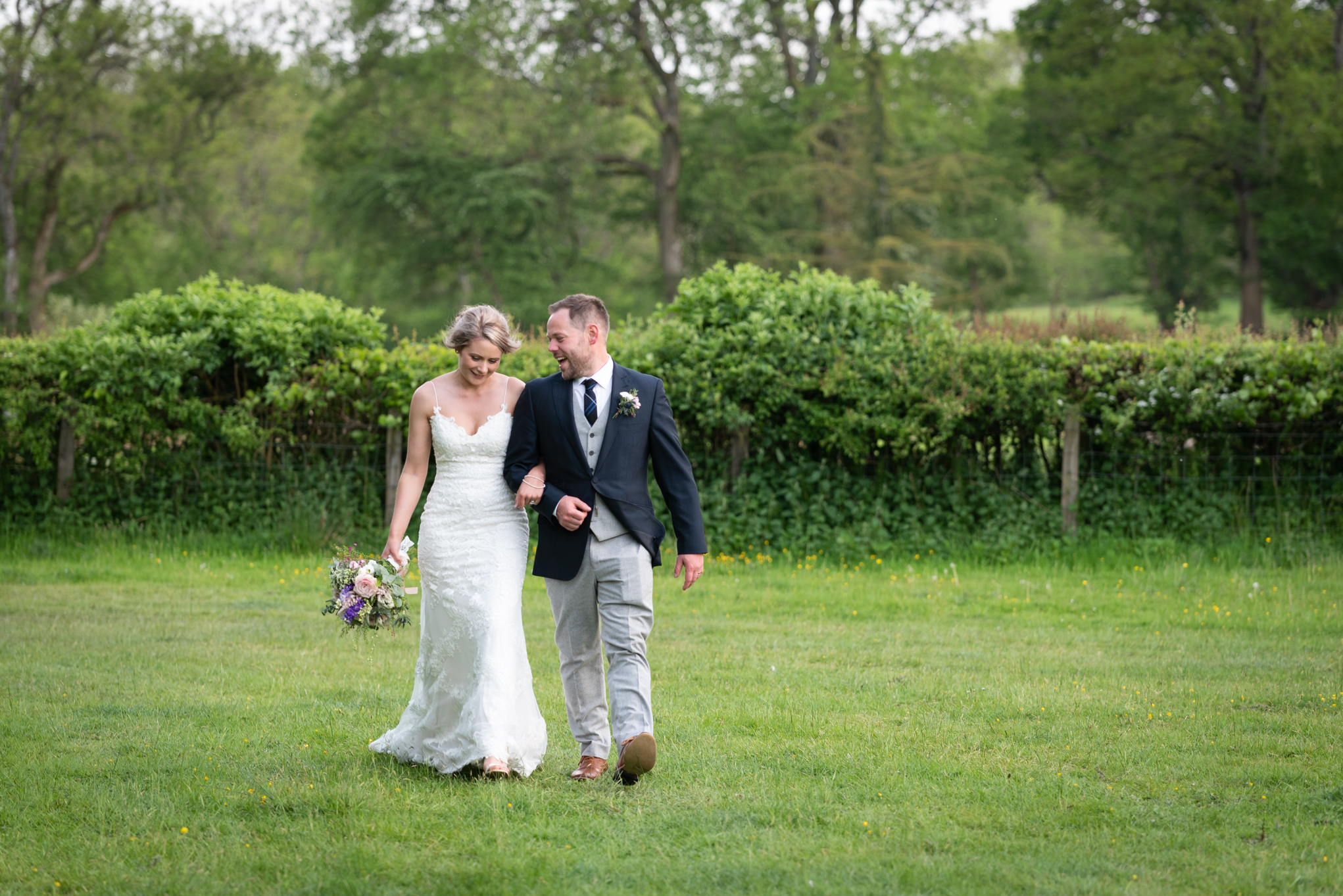Bride and groom walking - Powys Wedding Photography