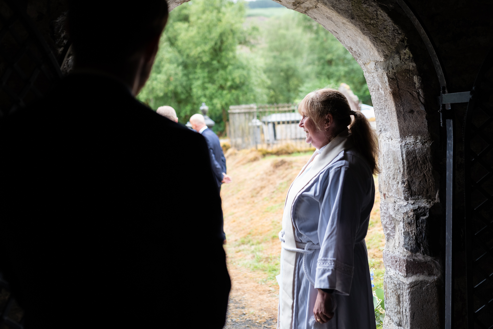 Vicar waiting for bride at wedding - Powys Wedding Photography