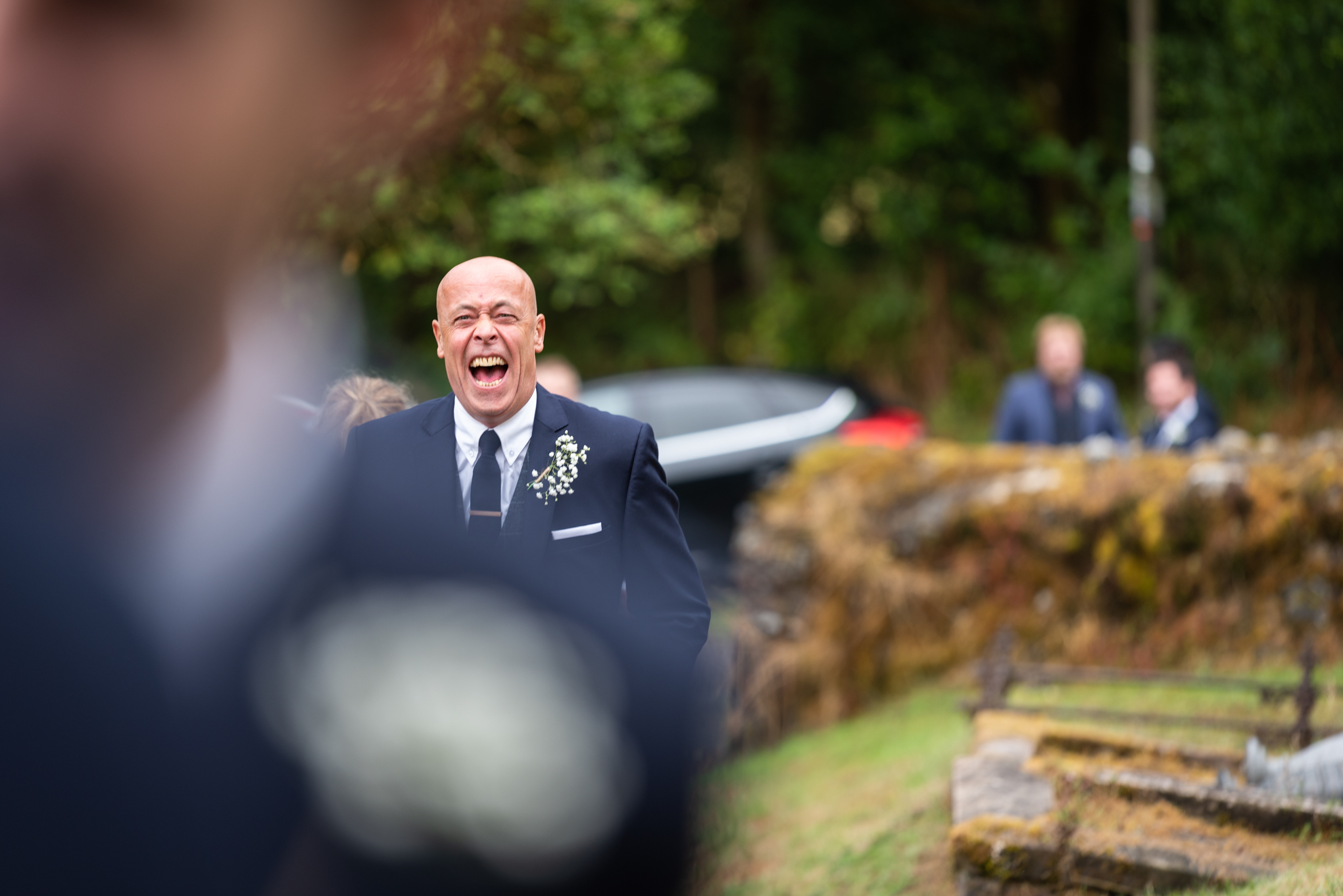 Guests laughing at wedding - Powys Wedding Photography