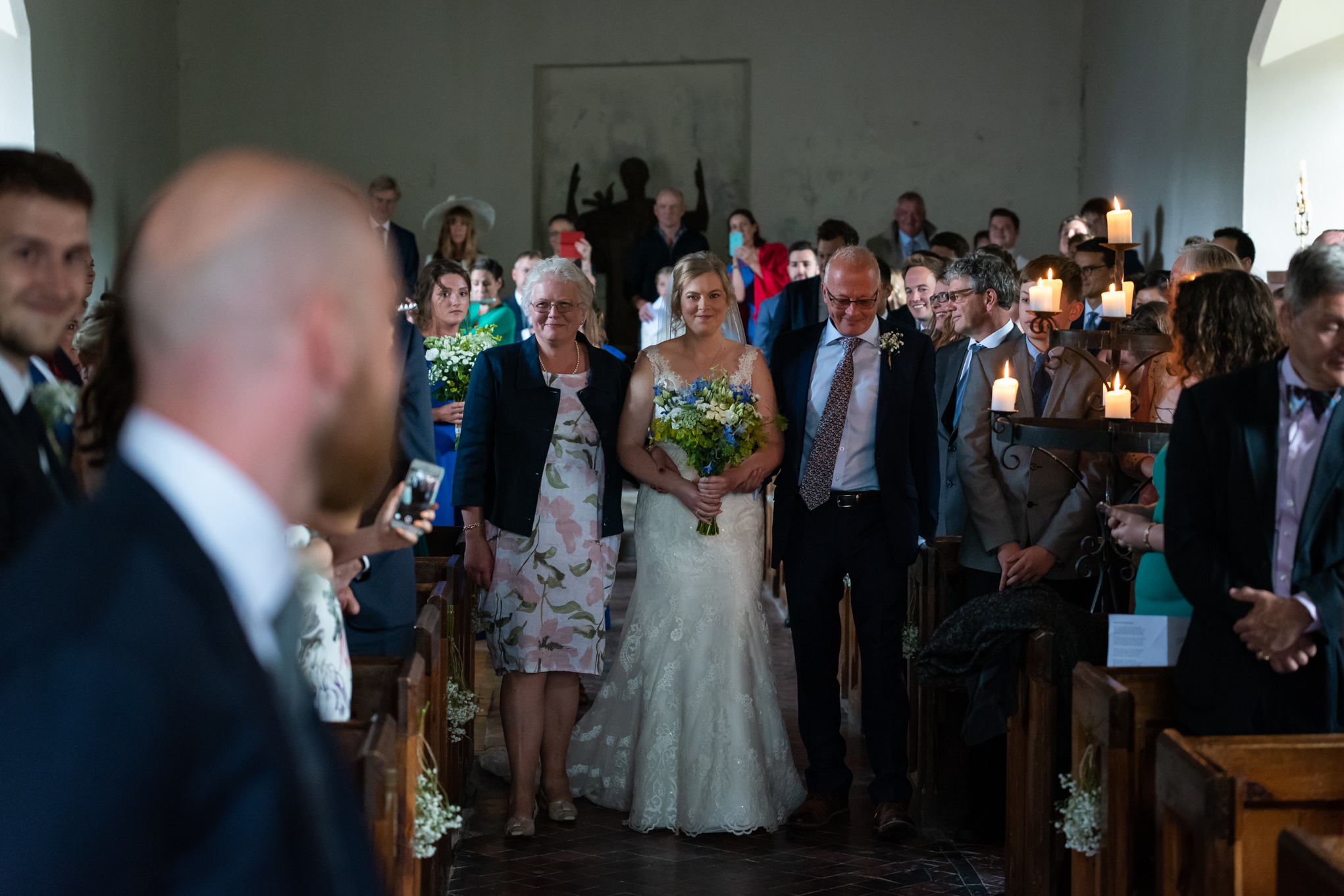 Bride entering church for wedding - Powys Wedding Photography