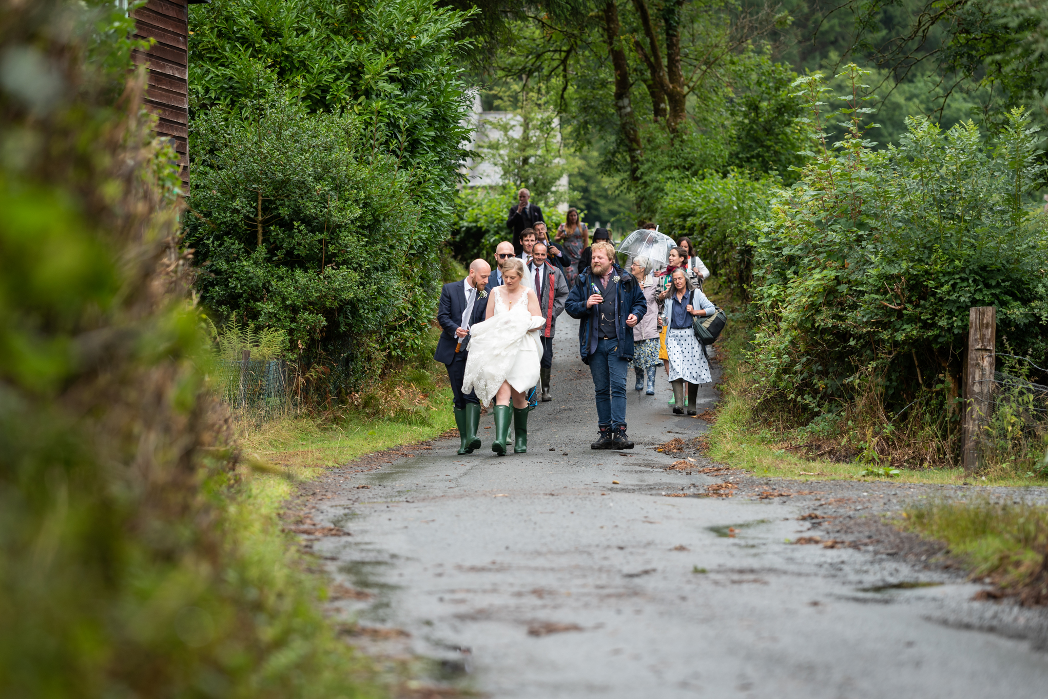 Wedding guests walking - Powys Wedding Photography