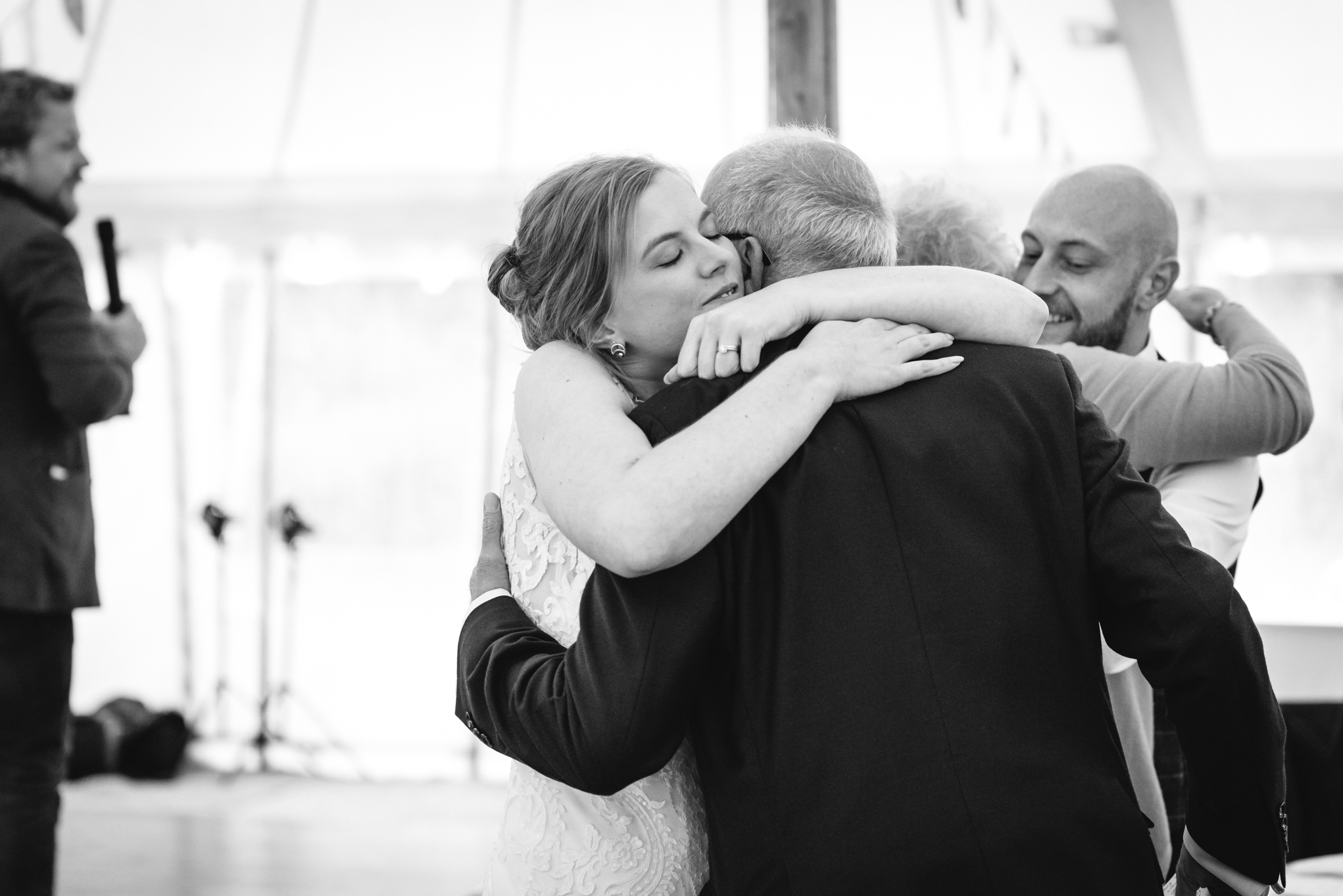 Bride hugging father - Powys Wedding Photography