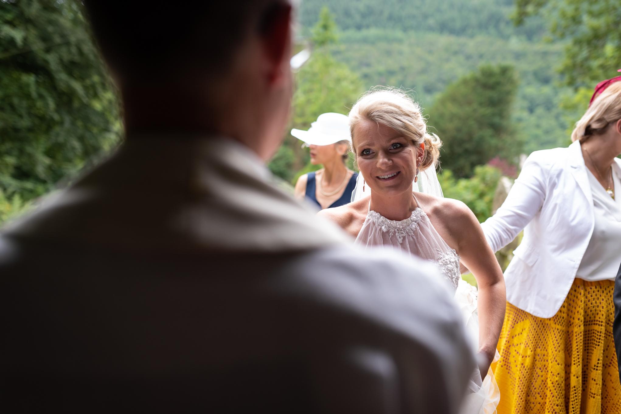 Copy of Bride arriving at Church talking to Vicar