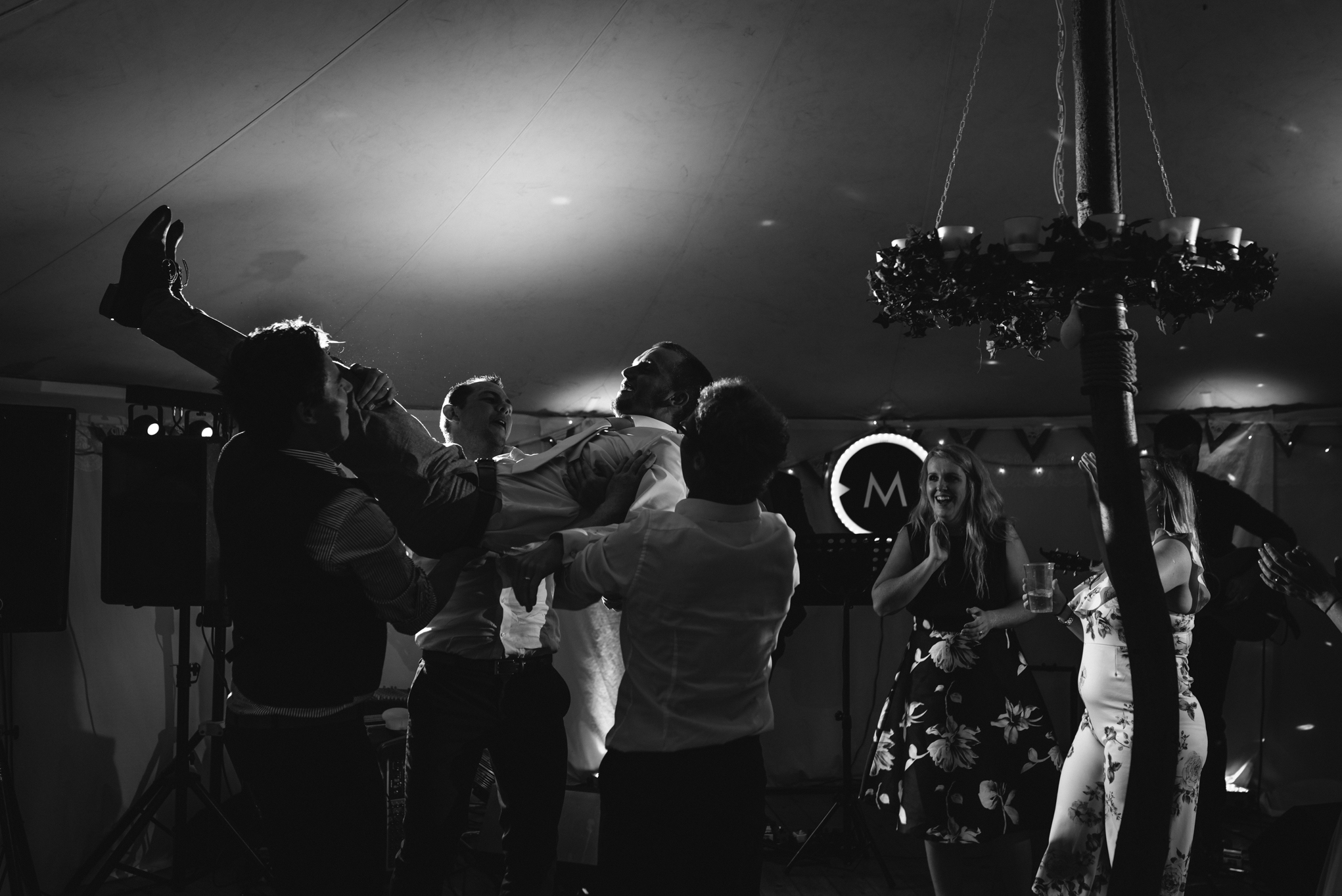 Copy of Groom Being Lifted Up at Wedding Party