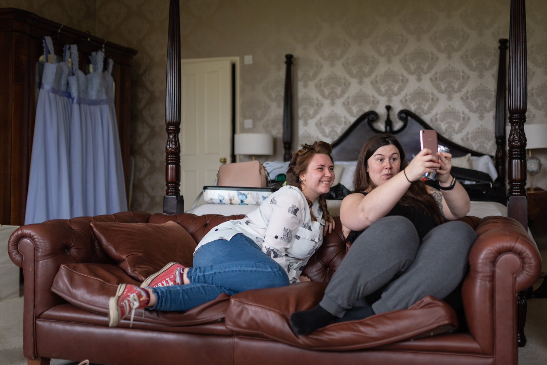 Bride and bridesmaid taking selfie