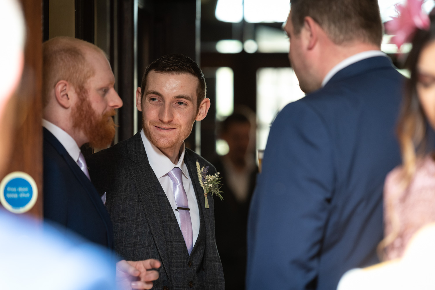 Groom talking with mates