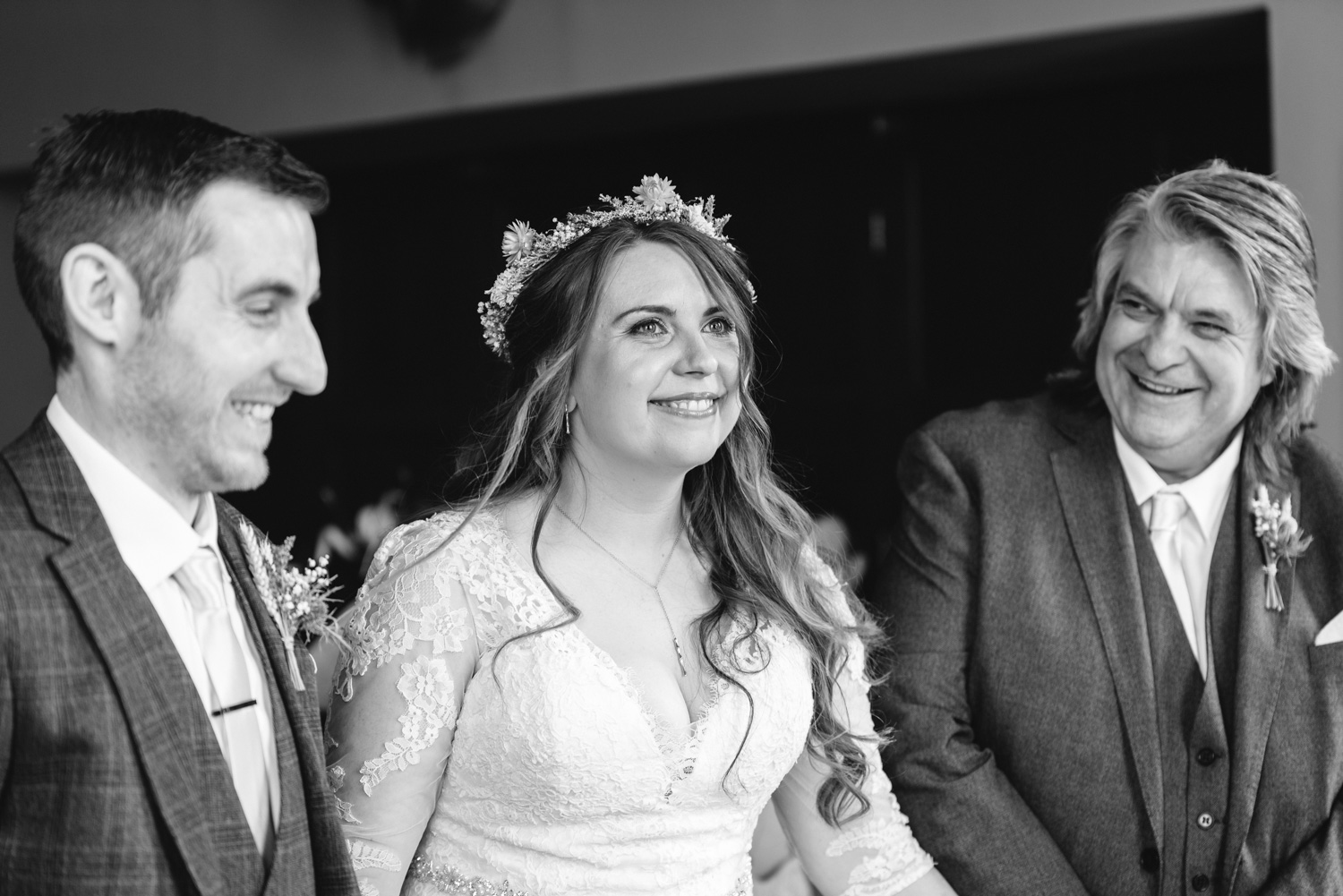 Bride, groom and father laughing