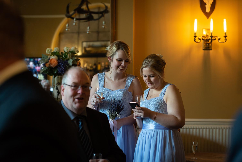Guests looking at phone