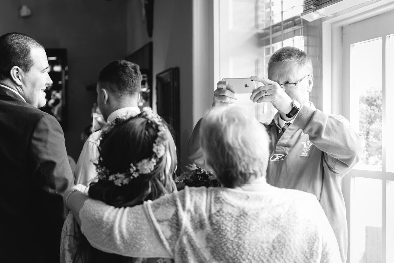Photograph of bride being taken