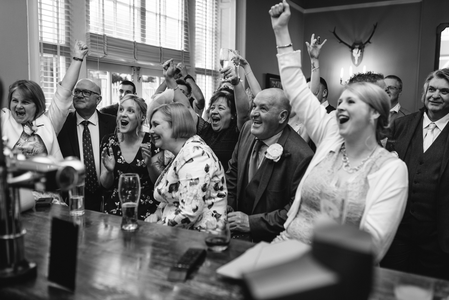 Wedding guests cheering rugby