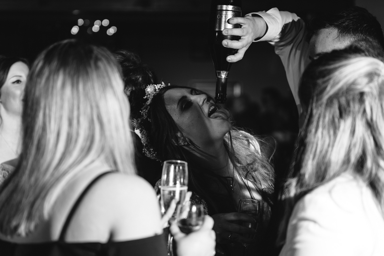 Bride drinking from bottle