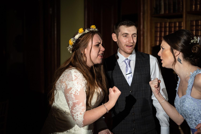 Bride and bridesmaid during wedding party