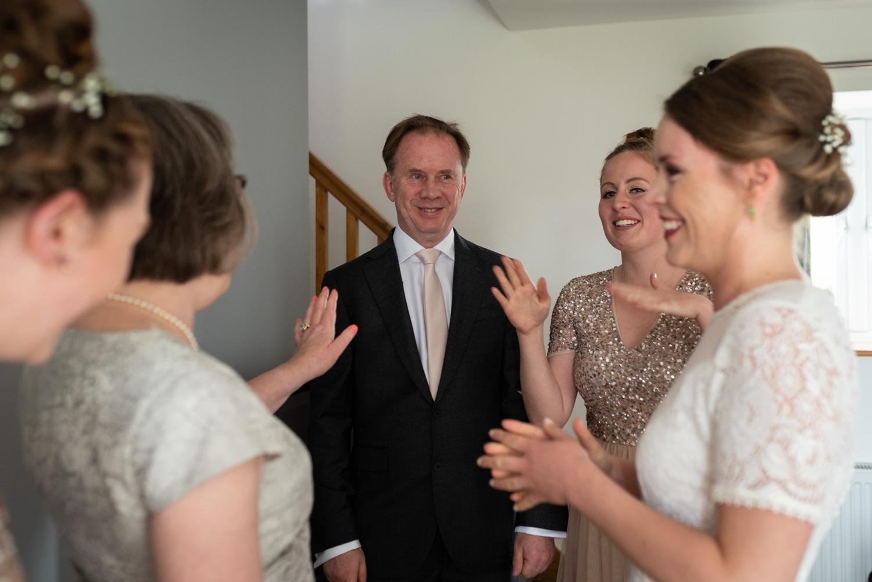 Father of bride looking happy when sees bride