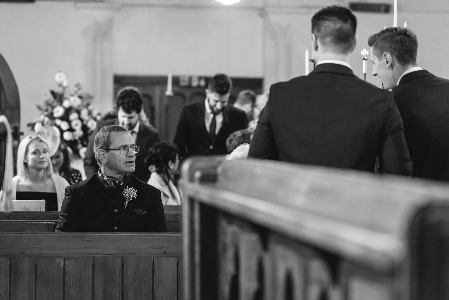 Groom and father talking at church