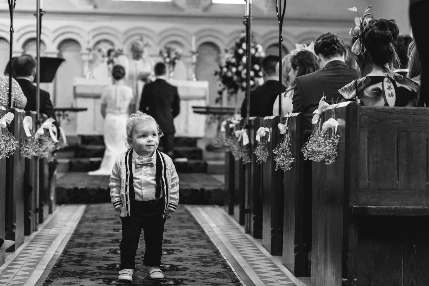 Toddler in church aisle during wedding