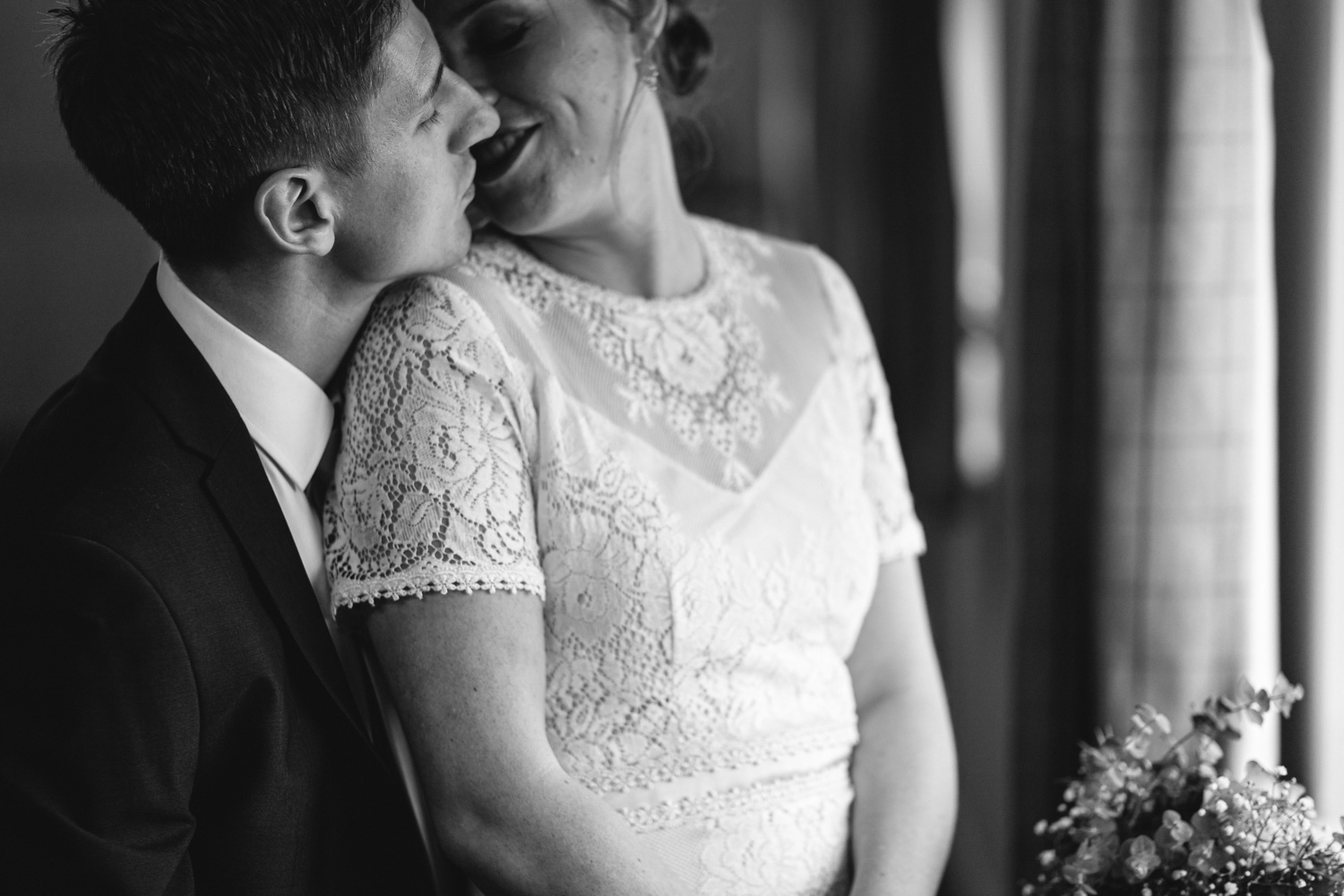 Bride and groom photograph kissing