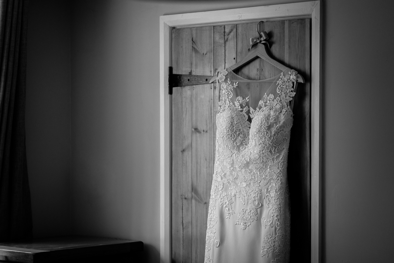Wedding dress hanging on doorframe