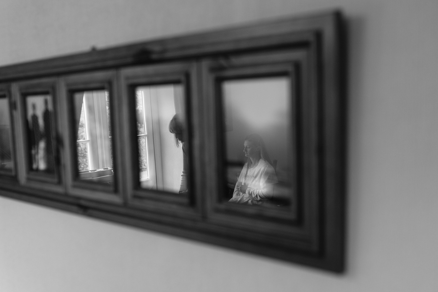 Brides reflection in photograph on wall