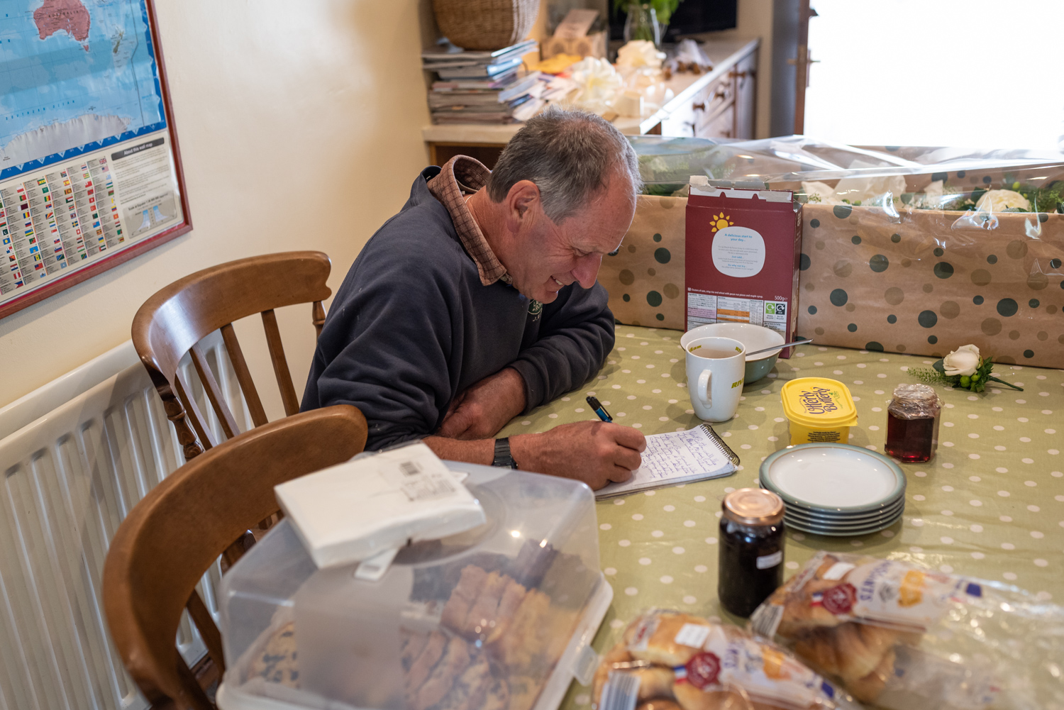 Dad writing speech at kitchen table