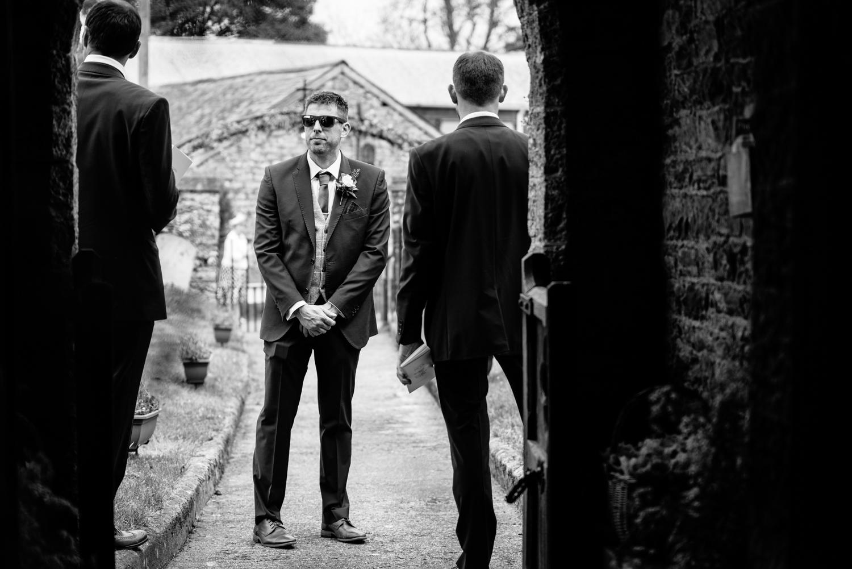 Best man stood waiting at church
