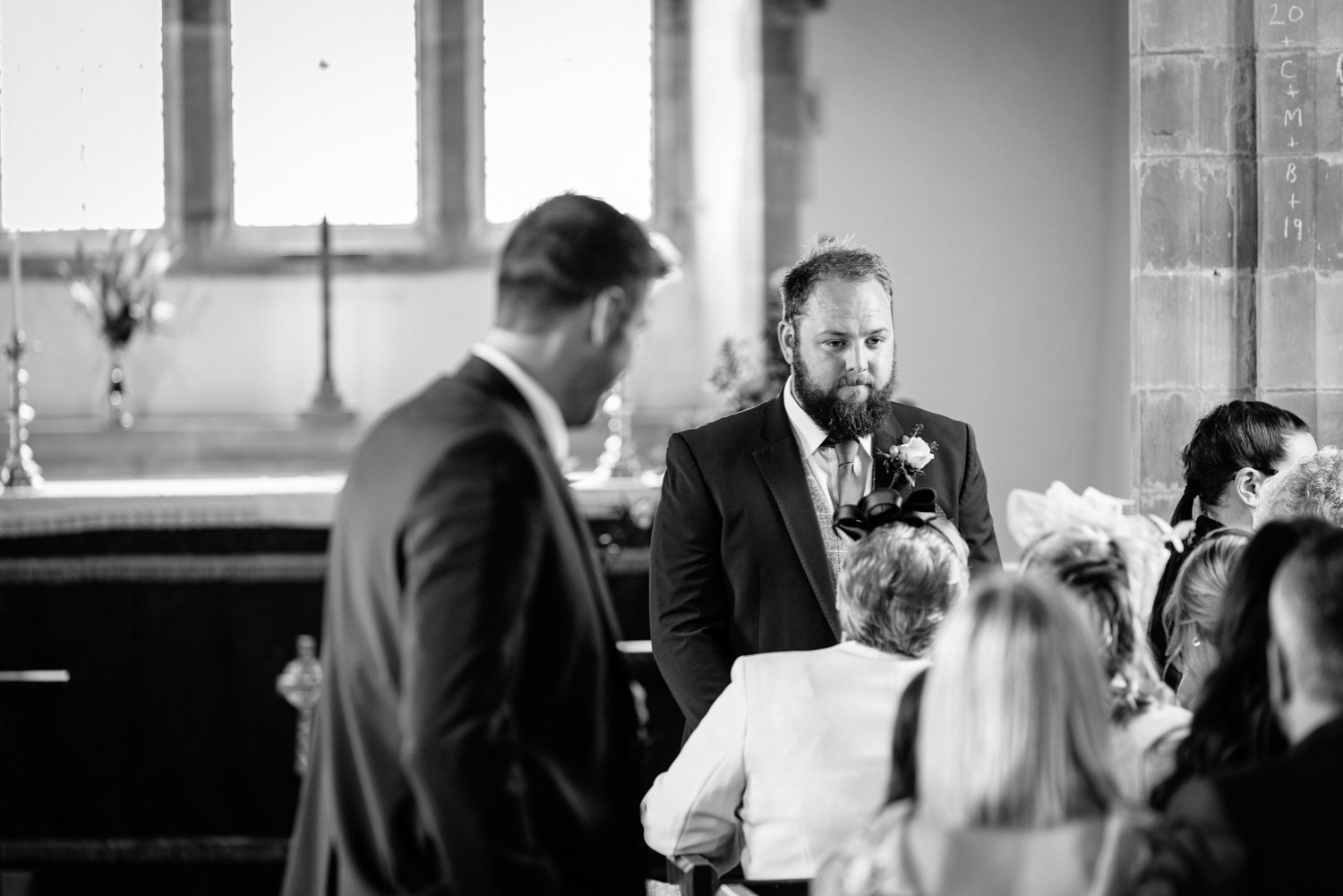 Groom stood at front of church