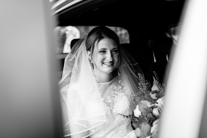 Bride in car arriving at church