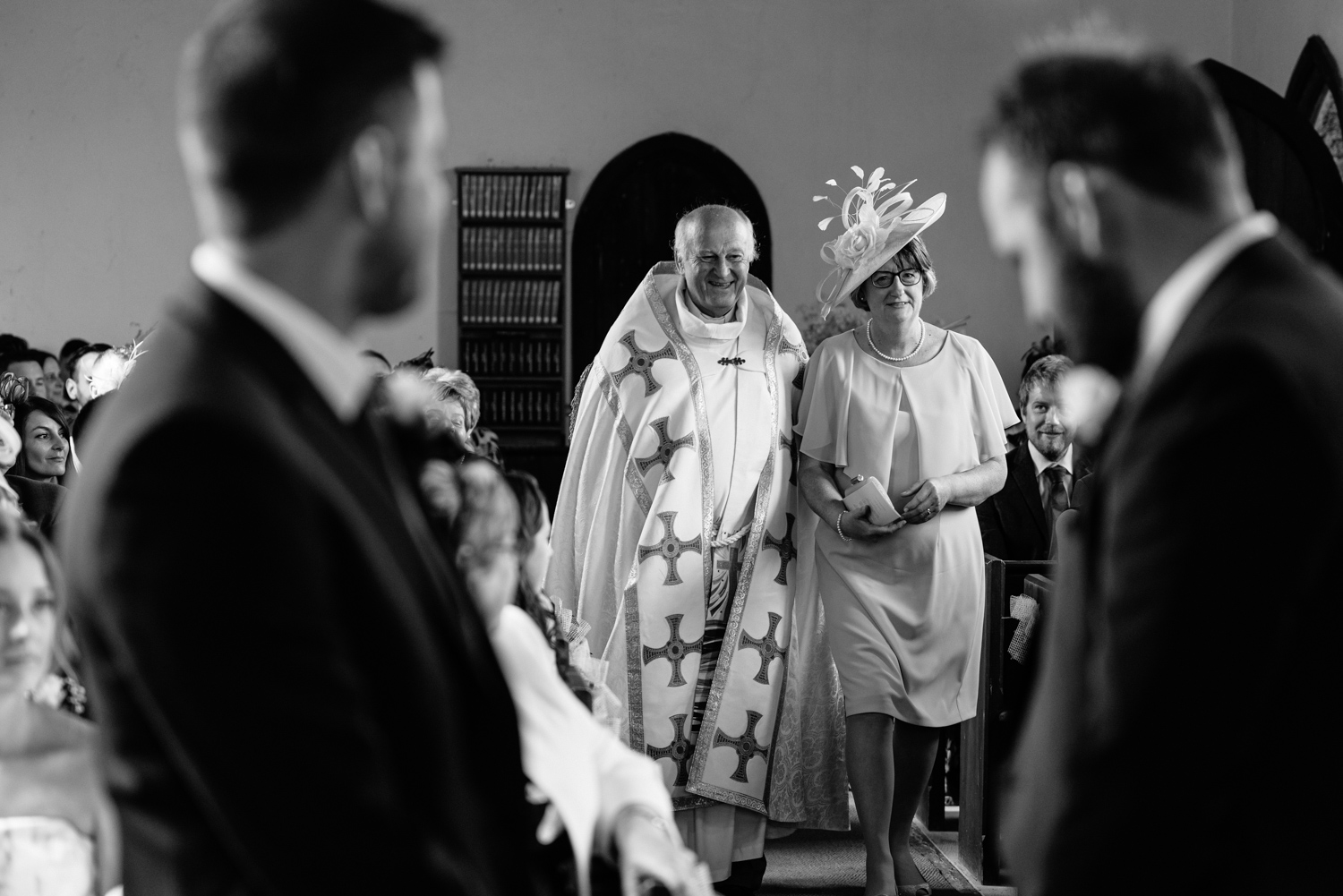 Vicar walking mother of bride down the aisle