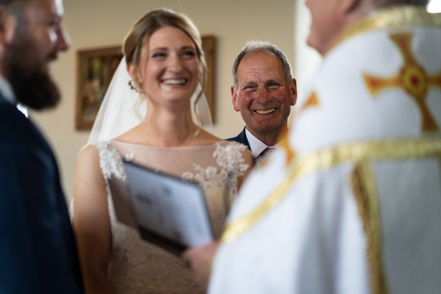 Bride and dad laughing during wedding