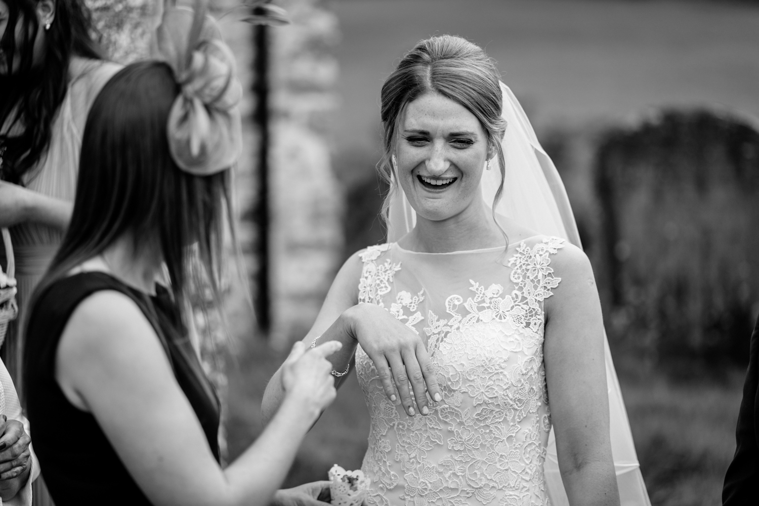 Bride with guest outside church