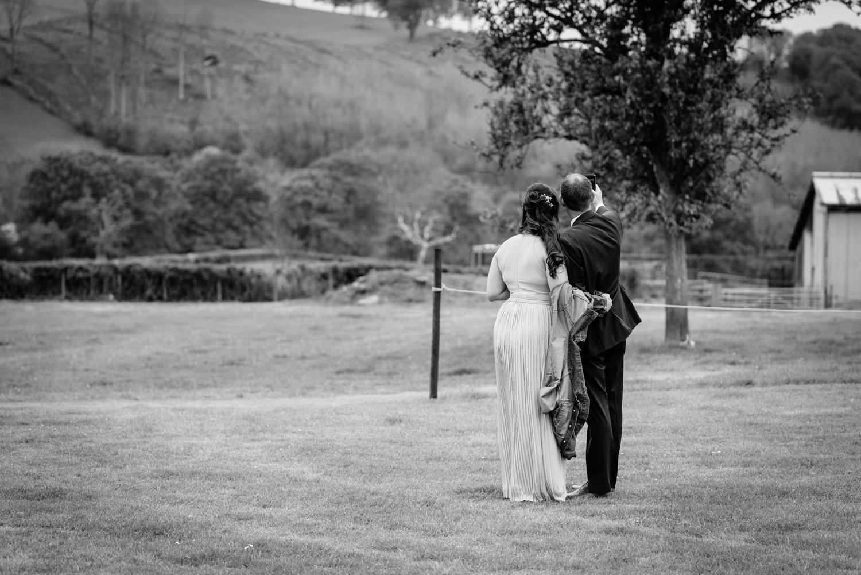 Bridesmaid and usher taking selfie