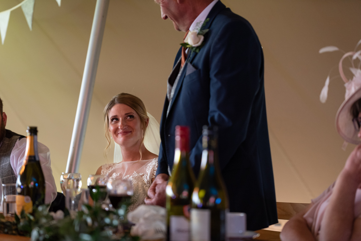 Bride looking at dad during his speech