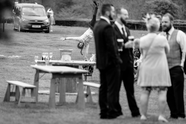 Man doing cartwheel at wedding