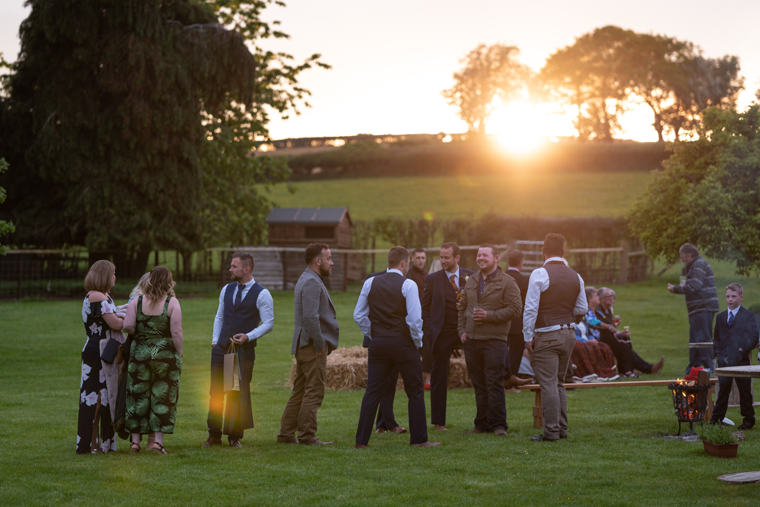 Sunset over wedding guests