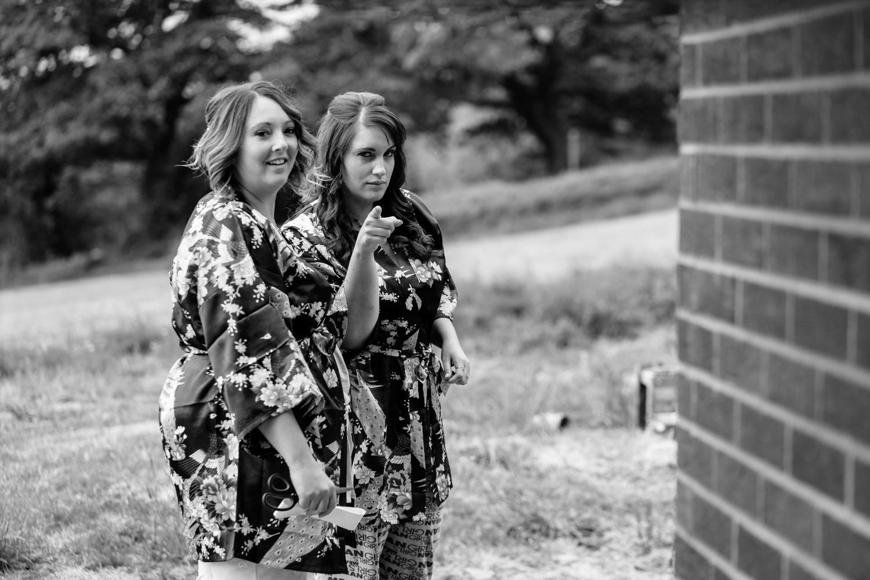 Bridesmaids pointing at camera