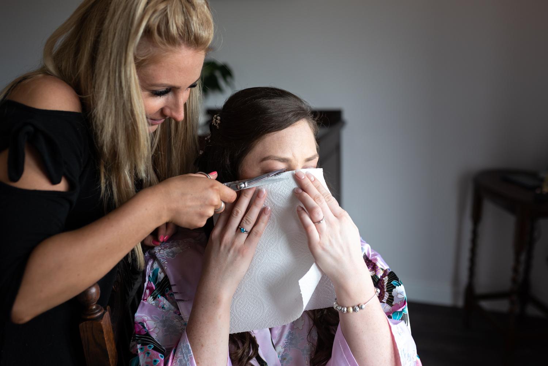 Brides eye lashes being cut