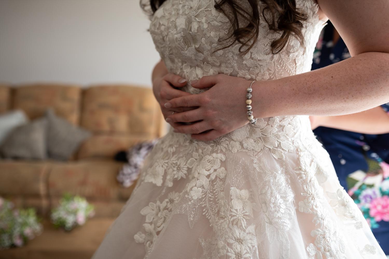 Brides hands on dress