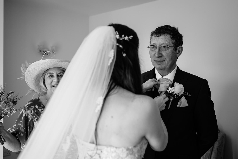 Bride doing dads tie