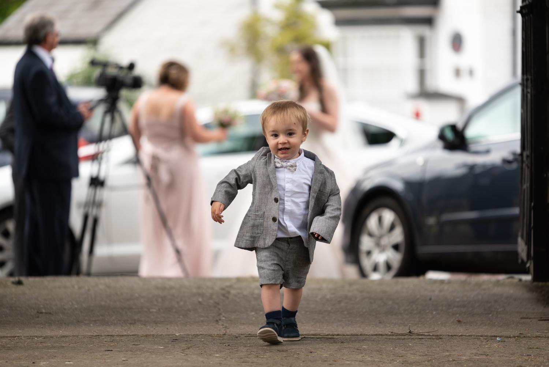 Boy running at church