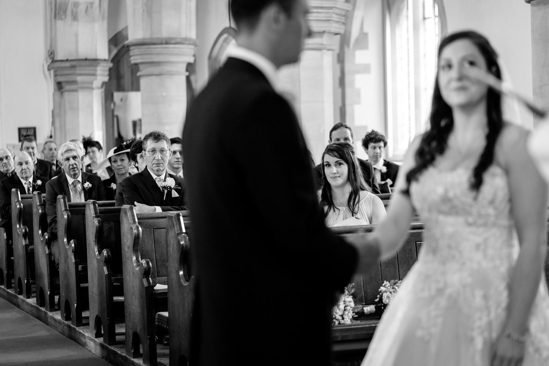 Bridesmaid watching wedding at church