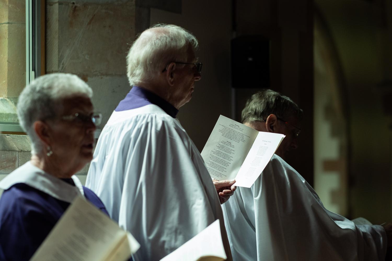 Choir stood singing at church