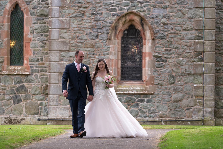 Bride & groom outside church